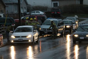 RAIN, SLEET AND SNOW County of Brant OPP officers and firefighters went to a collision scene on Dundas Street West near Arnold Street in Paris, Ontario the evening of Thursday, Dec. 20, 2012. No one appeared to be hurt, but a spill had to be cleaned up by the firefighters. Wet and slick conditions caused by a mix of freezing rain, snow and rain made driving treacherous throughout the evening. More snow - albeit flurries - is forecasted for late Friday and on Saturday.  MICHAEL PEELING/THE PARIS STAR/QMI AGENCY