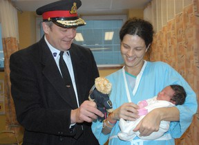 Chief Bob Davies visits with Courtney Pine and her daughter, Samantha, at Sault Area Hospital on Friday, Dec. 21, 2012.