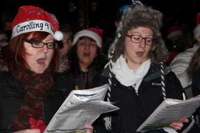 Carollers sing outside Reanna Pyne's home in Sarnia, Ont. Monday, Dec. 24, 2012. The event was organized on Facebook after several Christmas decorations belonging to the terminally ill teen were destroyed by vandals. (BARBARA SIMPSON, The Observer)