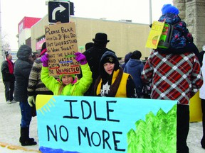 Protesters hoist signs on Saskatchewan Ave. at Royal Rd. during an Idle No More demonstration, Friday afternoon. Many groups gathered at City Hall to speak out against federal omnibus Bill C-45. (ROBIN DUDGEON/PORTAGE DAILY GRAPHIC/QMI AGENCY)