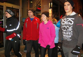Runners and participants line up outside Niko's Eatery & Bar Friday evening for the third annual Tillsonburg Resolution Run, coordinated by Sole Mates, a local running group. The annual event is a great way for many to kick-start their 2013 New Year's resolutions and helps raise food donations for the Helping Hand Food Bank in Tillsonburg.  KRISTINE JEAN/TILLSONBURG NEWS/QMI AGENCY