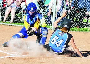 Wetaskiwin Wild catcher Hannah MacDonald attempts to make a tag, but it was a little too late as Rylee Cassidy of Red Deer crosses the plate. The teams would meet again in the gold medal game of the U12 girls softball provincials held in Wetaskiwin in July.