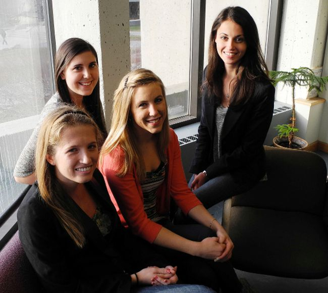 Queen's University roommates, from left, Rachel Albi, Sarnia's Erica Gagne, Jessica Jonker and Amanda Smurthwaite started the Facebook profile Queens U Compliments. The concept has since spread to about 100 other schools. QMI AGENCY