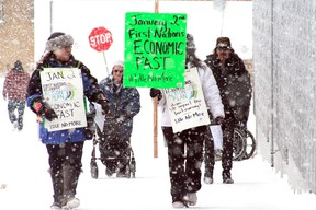 """Tania Cameron (left) and Marlene Elder were among four teams of demonstrators handing out leaflets throughout Kenora on Wednesday as part of a one-day """"economic fast"""" that called First Nations people to boycott all local businesses."""
