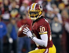 Washington Redskins quarterback Robert Griffin III looks to pass against the Seattle Seahawks during their NFL NFC wildcard playoff game in Landover, Maryland January 6, 2013. (LAURENCE KESTERSON/Reuters)