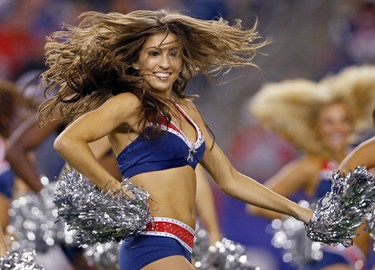 New England Patriots cheerleaders perform during a NFL football game against the New York Giants in Foxborough, Massachusetts September 1, 2011. (REUTERS/Adam Hunger)