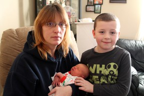 Nicole McClellan, her son Logan and partner Dwayne Bates (not pictured) welcomed Paris' first newborn baby of 2013, Erica Lynne Bates, on Tuesday, Jan. 1 at 3:27 p.m. in the Brantford General Hospital. Erica weighed 7 pounds. MICHAEL PEELING/THE PARIS STAR/QMI AGENCY