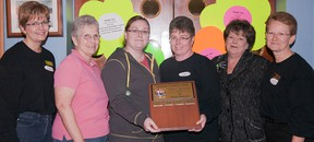 Linda Stykel (left) event co-chairwoman of Trenton Curling Club's annual ladies Flower Power Bonspiel, held last weekend, is joined by the 'A' event winners from TCC — Liz Griffiths (lead), Megan Bridger (second), Melanie Harder (vice), and Barb Sopaz (skip), and event chairwoman Arduth Paquette.