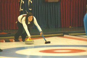 Airdrie's Heather Jensen slides out of the hack while, right, she calls to her sweepers during the Southern Alberta women's curling playdowns at the Glencoe Club in Calgary on Jan. 5. Jensen failed to qualify for the provincials, losing to Cheryl Bernard in the C event semifinals.