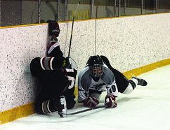 A crash into the board wasn't enough to bring down the Fort Saskatchewan Junior Fury, who pulled off a 2-1 win over the second-place Sherwood Park Steele last weekend. Shane Jones/QMI Agency