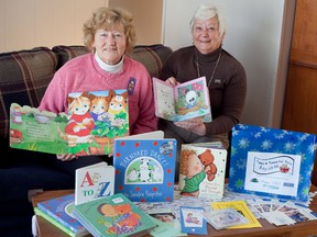 Teresa Dorey and Beryl Jacka display some of the children's books they've collected to be distributed to newborns and toddlers in Lennox & Addington County, through the Retired Women Teachers of Ontario Napanee Branch's Tales and Tunes for Tots program.