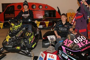Dave Joanis, on the 2012 Ski-Doo 600RS snowmobile that he raced in last years Cochrane Gold Cup and his mom, Chantal Joanis, on her 1992 Polaris 650, at the Cochrane Classic Vintage Riders Snowmobile Museum.