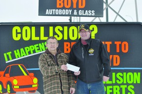 Boyd Autobody & Glass location manager Leonard Roy presents a $2000 cheque to Shane Moffat, BDO Centre for the Commmunity rink manager. The money will be used to help purchase a new ice plant. (Kevin Hirschfield/PORTAGE DAILY GRAPHIC/QMI AGENCY)