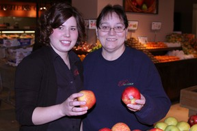 Pick of the Crop employees Breanna Cylbulski, left, and Yvonne C. Gauthier were on hand for the opening of the new grocery in Timmins Friday.
