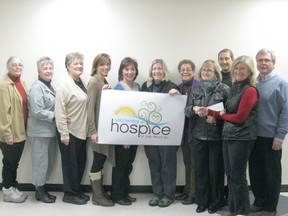 Pictured from left to right: Marie Palmer, Mary Anne Bishop, Bev Morely and the members of the Hospice foundation,Tanya Quanz, daughter of Marilyn Hills, Carol Ann D'Andrea and Martha Bennett, both Cham-bettes, Verona Jackson of the Hospice Foundation and Mary Ellen Renaud, president of the Chantry Island Cham-bettes presenting the cheque to  Ruth Lovell Stanners, chair of the Grey Bruce Hospice Foundation. Pictured in the back are Bob Cordell and Dr. Bruce Stanners  of the Hospice Foundation.