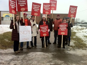 Teachers belonging to the Elementary Teachers Federation of Ontario protest outside J.G Simcoe Public School, legally, during a break on Friday. The Ontario Labour Relations Board ruled early Friday morning that the union's plan to have workers walk out of classes for the entire school day was an illegal strike.