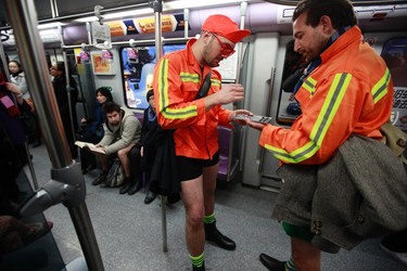 """Two men not wearing pants play chess on the subway during the annual """"No Pants Subway Ride"""" in Shanghai January 13, 2013. The event, organized by performance art group Improv Everywhere, involves participants who strip down to their underwear as they go about their normal routine.  REUTERS/Aly Song"""