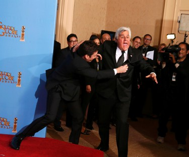 Late night talk show hosts Jimmy Fallon (L) and Jay Leno joke around backstage at the 70th annual Golden Globe Awards in Beverly Hills, California, January 13, 2013.  REUTERS/Lucy Nicholson (UNITED STATES  - Tags: ENTERTAINMENT)   (GOLDENGLOBES-BACKSTAGE)