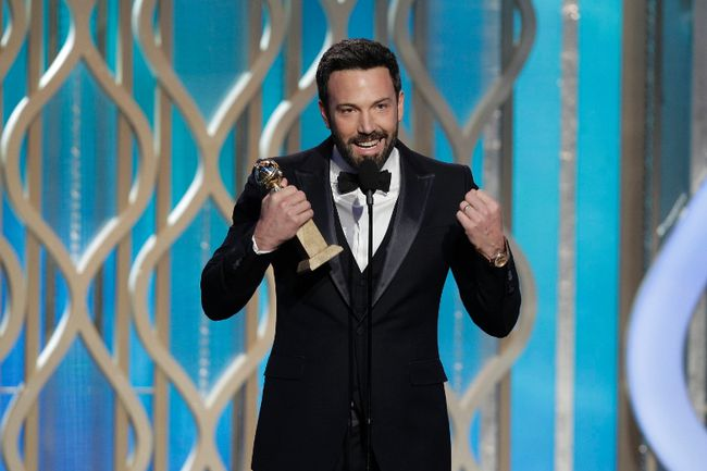 "Ben Affleck accepts the award for Best Director - Motion Picture for ""Argo"" on stage on at the Golden Globe Awards in Beverly Hills, California January 13, 2013, in this picture provided by NBC. REUTERS/Paul Drinkwater/NBC/Handout"