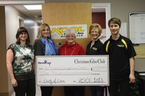 """Members of the LCSD Glee Club strike a pose. The group rewrote the wonds to """"Grandma Got Run Over By A Reindeer"""" and won $1,000 in KOOL Radio's Christmas glee club contrest, with the money going to the Dr. Margaret Savage Crisis Centre's transitional housing program."""