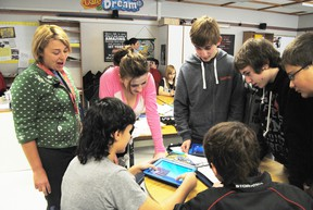 Some of Connor Butler's classmates crowd in around him as he demonstrates one of the features he is putting into his project about ancient an ancient Aztec empire using an iPad tablet as part of the 1-2-1 Mobile Tablet project.   Barry Kerton | Whitecourt Star