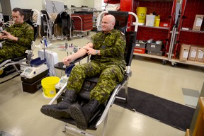 Lt. Terry Wynn donates blood for the first time this year, at a Canadian Blood Services donor clinic at CFB Trenton Monday morning.  Emily Mountney Trentonian