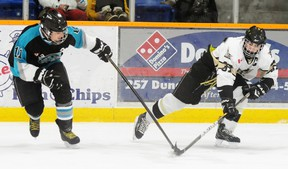Quinte West Major Midget Hawks' captain Andy Paul battles with Lindsay Muskies' Mitch Naylor during the Hawks' 4-0 win last Thursday at the Gardens.