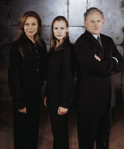 <b>ALIAS:</b> Yeah, I know Sydney and her evil mom (Lena Olin) were fighting to the death in that final episode. But death is malleable in TV, and we definitely see them as mom-and-daughter sitcom roommates. LENA OLIN, JENNIFER GARNER, VICTOR GARBER Original Filename was 661049ful.jpg Processed: Wednesday, July 16, 2003 1:26:25 PM