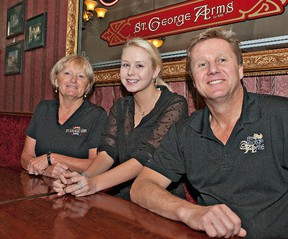 Seventeen year old Erika Crawford (centre) of St. George visits with Marilyn Hamilton and Bob Dolman, owner of the St. George Arms, on Jan. 15.  Dolman presented a cheque to the Crawford family for $5,510 representing the proceeds of a fundraiser held throughout November and December. The Crawford's have had to travel to the United States on numerous occasions for Erika's surgery and treatment for Ehlers-Danlos Syndrome. (BRIAN THOMPSON Brantford Expositor)