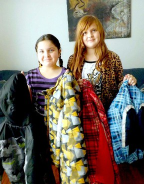 Kincardine's Rahfah Faddah and sister Hoda display some of the winter jackets they are collecting to send to refugees of the Syrian civil war. Donations to the cause can be made at Kincardine Township Tiverton Public School by Jan. 24-25, 2012.