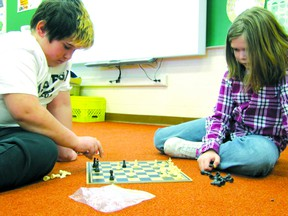 Elmer Elson Elementary School Grade 5 students Conrad Tordzik, left, and Jesse Mosher play chess, one of the house league board games competitions on Tuesday, Jan. 15.