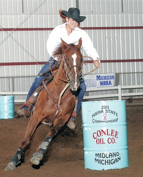 Britney Lemieux and Breezer compete in Michigan in 2011. The pair has emerged 2012 National Barrel Horse Association world qualifiers.