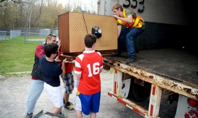 An old television is lifted into the back of a truck with some help from members of the Quinte West Youth Centre last April, where staff and youth held an electronics recycling drive. They have organized another one for this Saturday, Jan. 26 Trentonian file photo