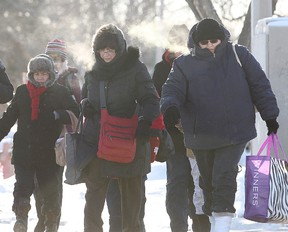 People bundle up in the cold.