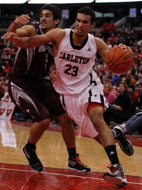 Gee-Gees' Mehdi Tihani, left, chases down Carleton Ravens' Philip Scrubb, right, during the MBNA Capital Hoops Classic in January at Scotiabank Place. (Darren Brown, Ottawa Sun)