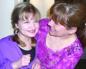 Abby Congram, 13, and mom Karen share a smile recently. (Contributed photo)