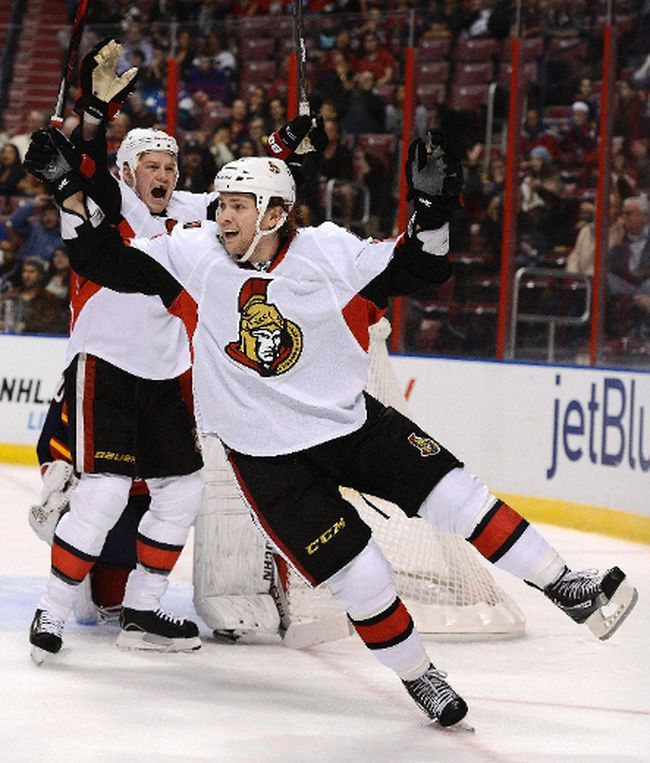 Ottawa Senators' Chris Neil (L) and Zack Smith (R) celebrate their goal against Florida Panthers goalie Jose Theodore (not pictured) during the first period of their NHL hockey game in Sunrise, Florida January 24, 2013.. REUTERS/Rhona Wise (UNITED STATES - Tags: SPORT ICE HOCKEY)
