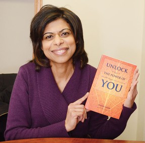 Wetaskiwin's Shanti Wellness Centre director Zaheen Nanji holds up Unlock the Power of You, 12 keys to health, happiness & success, which she helped co-write.