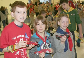 Brendan Peters, 10, Eric Dodman, 9, both of 19th Chatham Cubs, and Mark Debevc, 7, of 4th Chatham Cubs, were among the participants at the annual Kub Kar rally held at the WISH Centre.