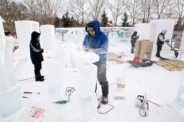 (Left to right) Sue McGrew, Sandis Kondrats, Fedor Markov and Egor Stepanov work on ice carvings ahead of the Ice On Whyte Festival at End of Steel Park in Edmonton, Alta., on Tuesday Jan. 22, 2013. The ice carvers are part of a International Ice Carving Competition. The festival runs from Jan. 25 to February 3. Ian Kucerak/Edmonton Sun/QMI Agency