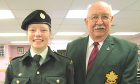 WO Amy Maxwell is presented a Cadet Service Medal by Ian McDermid, Army Cadet League representative.