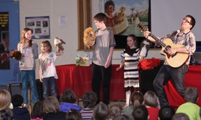 KEVIN RUSHWORTH PHOTO. Children's author and workshop speaker, Victor Lethbridge travelled to each of the area schools to perform and read from his first book, Little Chief and Mighty Gopher: The Pemmican Frenzy. Pictured above, Lethbridge performs a song that goes along with his book with Livingstone School students.