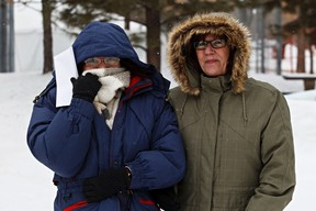 Ruth Vinluan, left, and Karen Mann look to be freezing during Ice on Whyte in Edmonton, Alta., on Monday, Jan. 28, 2013. Temperatures are projected to plummet below -30C with windchill tomorrow. Codie McLachlan/Edmonton Sun/QMI Agency