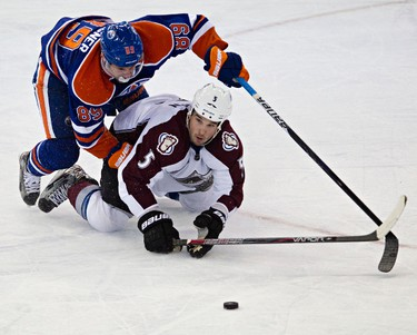 Edmonton's Sam Gagner and Colorado's Shane O'Brien battle for the puck during the third period of the Edmonton Oilers' NHL hockey game against the Colorado Avalanche at Rexall Place in Edmonton, Alta., on Monday, Jan. 28, 2013. Codie McLachlan/Edmonton Sun/QMI Agency