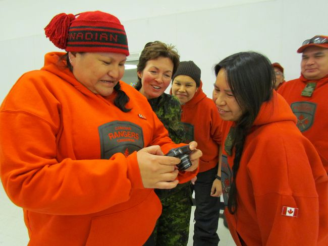 Col. Jennie Carignan, second from left, joins in the laughter as Canadian Rangers in Peawanuck look at photographs on a digital camera. Carignan recently spent a four-day visit in Northern Ontario.