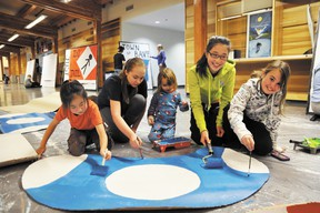 Banff skaters paint mushrooms on Sunday, Jan. 27 at the Fenlands in preparation for the Saturday, Feb. 2 ice skate show called What Game Do You Want to Play? CORRIE DIMANNO/BANFF CRAG & CANYON/QMI AGENCY
