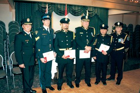 reaty Three Police Service Chief Conrad DeLarond (left) and Deputy Chief Terry Armstrong (right) flank Queen Elizabeth ll Diamond Jubilee Medal recipients Det. Sgt. Doug MacKenzie, Const. Mitchell Boulette, Chief Brian Rupert (retired) and Const. Justin Booth. The medal was also presented posthumously to Mr. Joe Red Thunderboy who was instrumental in the formation of the aboriginal police force and served as chairman of the Treaty 3 police services board for seven years. REG CLAYTON/Daily Miner and News
