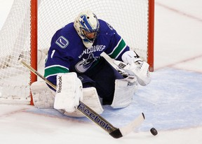 Canucks goaltender Roberto Luongo makes a save against the Avalanche during second period NHL action in Vancouver on Wednesday, Jan. 30, 2013. (Ben Nelms/Reuters)
