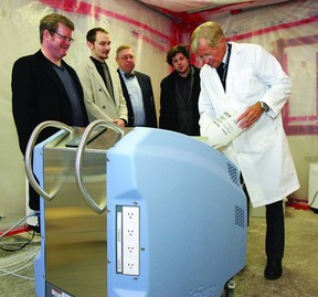 Dr. Michael Shannon, director of medical affairs with C3 Contamination Control Corporation, demonstrates the new AsepticSure decontamination system to (l-r) Bob Simpson, company co-founder, Dylan Simpson, lead crew chief, Gardiner McBride, managing director and co-founder, and Rory Nauman, technical analyst.     ROB MOOY - KINGSTON THIS WEEK