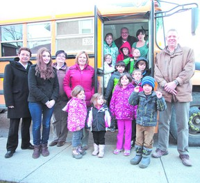 Staff, volunteers, and kids who attend the Salvation Army Friends Club welcomed a big yellow bus that will help transport kids to the after-school program, thanks to the generosity of Sean Payne at Martin's Bus Service (right).